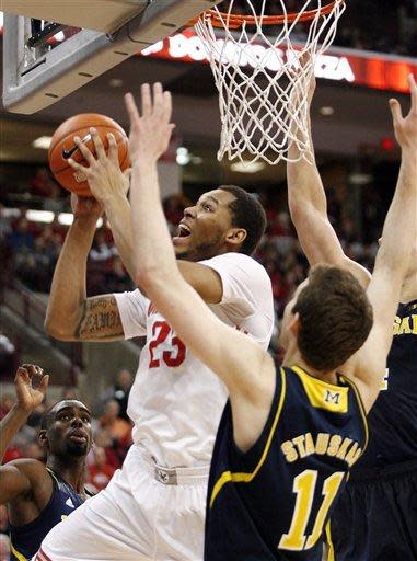 Ohio State's Amir Williams (23) shoots surrounded by Michigan defenders during the first half of an NCAA college basketball game on Sunday, Jan. 13, 2013, in Columbus, Ohio. (AP Photo/Mike Munden)