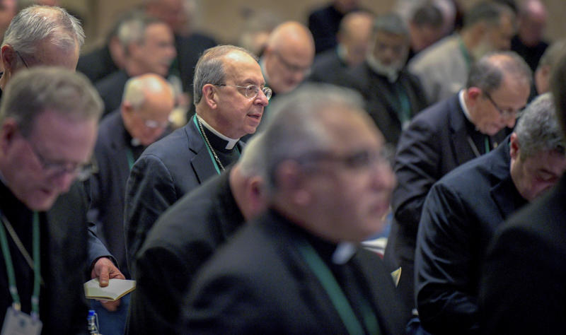 William Lori, Archbishop of Baltimore, stands during the opening prayer of the United States Conference of Catholic Bishops Fall General Assembly at the Baltimore Marriott Waterfront Monday, Nov. 11, 2019.  (Jerry Jackson/The Baltimore Sun via AP)