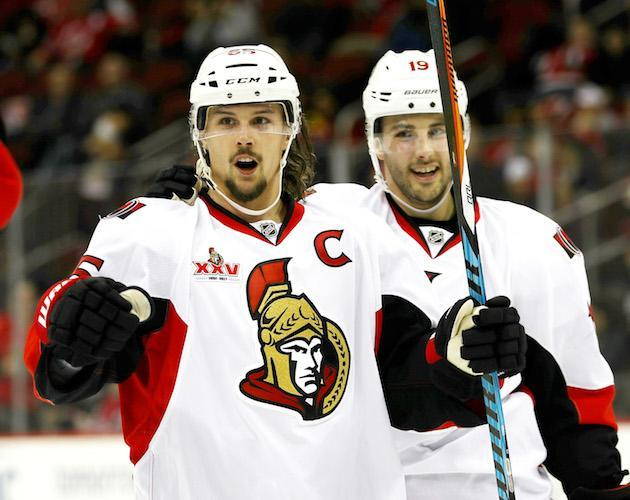 """NEWARK, NJ – FEBRUARY 16: <a class=""""link rapid-noclick-resp"""" href=""""/nhl/players/4491/"""" data-ylk=""""slk:Erik Karlsson"""">Erik Karlsson</a> #65 of the <a class=""""link rapid-noclick-resp"""" href=""""/nhl/teams/ott/"""" data-ylk=""""slk:Ottawa Senators"""">Ottawa Senators</a> celebrates his goal as teammate <a class=""""link rapid-noclick-resp"""" href=""""/nhl/players/3987/"""" data-ylk=""""slk:Derick Brassard"""">Derick Brassard</a> #19 stands by in the third period against the <a class=""""link rapid-noclick-resp"""" href=""""/nhl/teams/njd/"""" data-ylk=""""slk:New Jersey Devils"""">New Jersey Devils</a> on February 16, 2017 at Prudential Center in Newark, New Jersey.The Ottawa Senators defeated the New Jersey Devils 3-0. (Photo by Elsa/Getty Images)"""