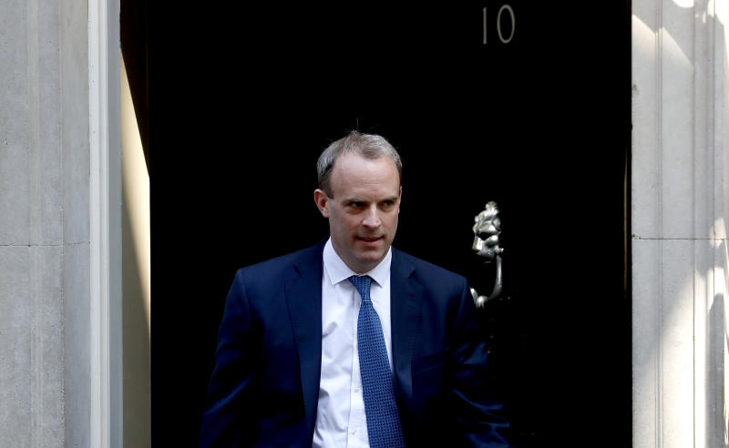 Britain's Foreign Secretary Dominic Raab leaves 10 Downing Street, London, Wednesday April 22, 2020. Dominic Raab will stand in for Prime Minister Boris Johnson at the weekly Prime Minister's Questions session, who is still recovering from a bout of COVID-19. (AP Photo/Frank Augstein)