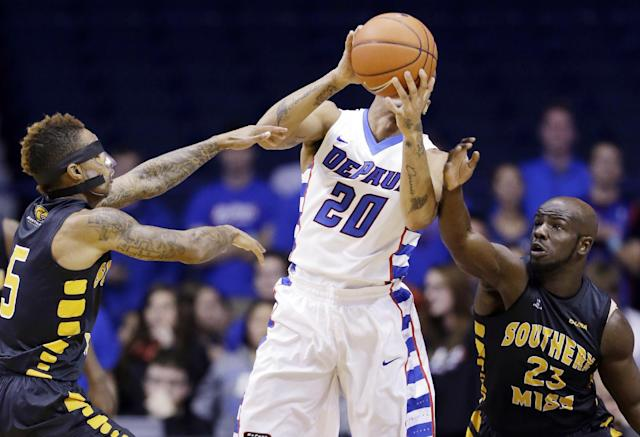 DePaul guard Brandon Young (20) tries to pass as Southern Mississippi guard Neil Watson, left, and guard Jerrold Brooks guard during the first half of an NCAA college basketball game in Rosemont, Ill., Wednesday, Nov. 13, 2013. (AP Photo/Nam Y. Huh)