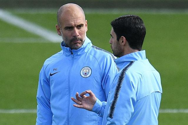 Manchester City manager Pep Guardiola (left) and assistant coach Mikel Arteta (AFP Photo/Oli SCARFF)