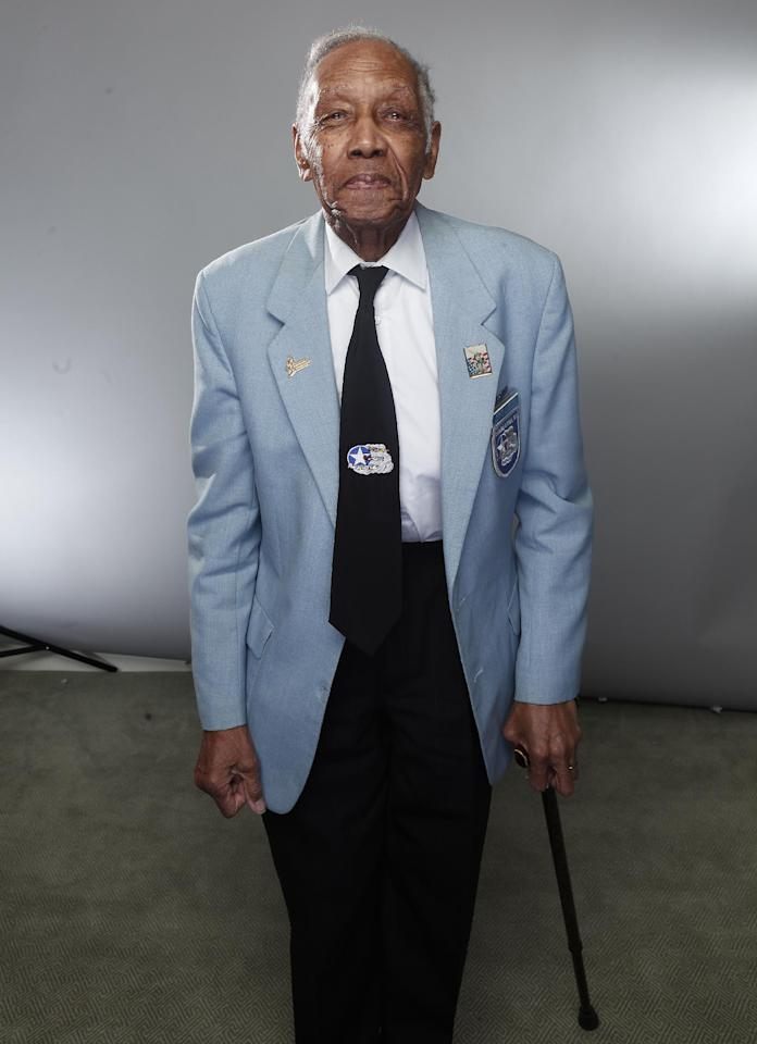 "In this Jan. 10, 2012 photo, Tuskegee airman Roscoe Draper poses for a portrait during the ""Red Tails"" press junket in New York. ""Red Tails,"" a film that chronicles the heroism of the Tuskegee Airmen, opens Friday, Jan. 20. (AP Photo/Carlo Allegri)"