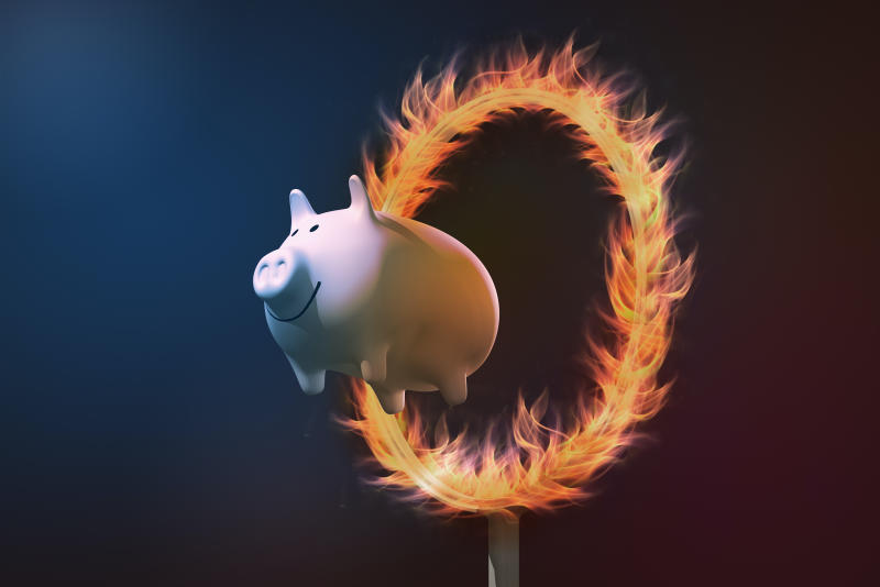 Piggy bank jumping through a ring of fire