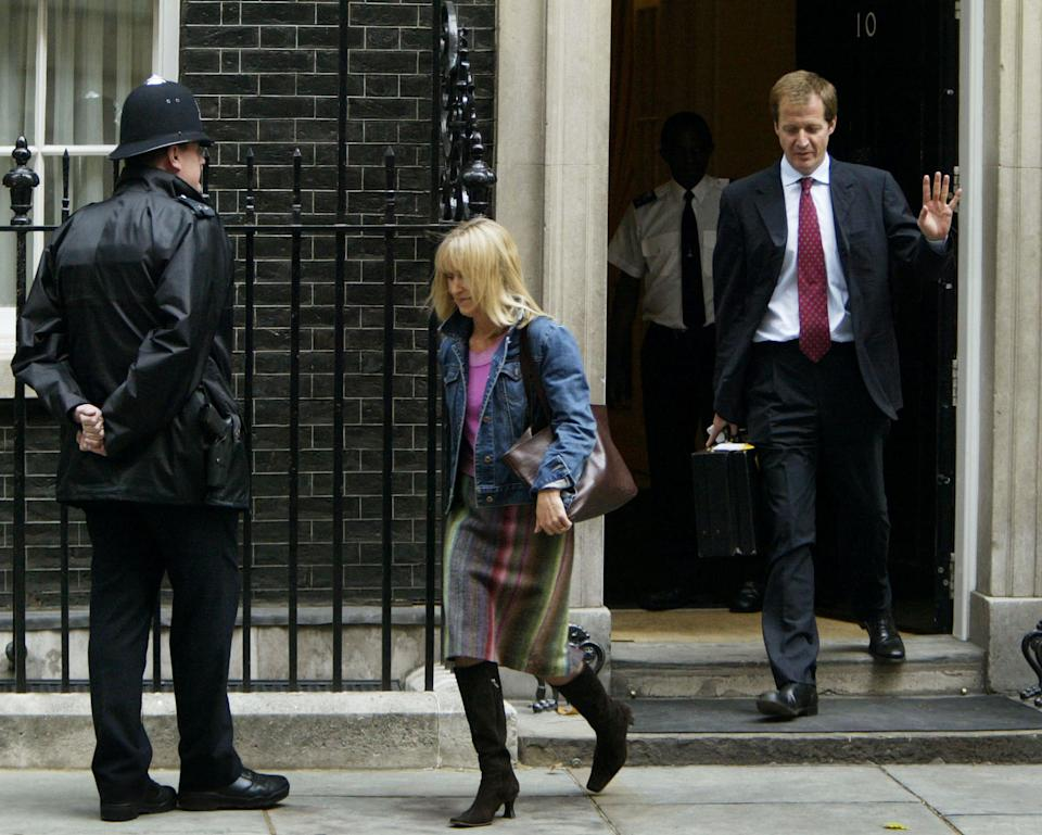 Alastair Campbell and his partner Fiona Millar leave Downing Street in 2003 after resigning. Campbell announced his resignation stating his family have suffered because of his job.  (Photo by Ian Waldie/Getty Images)