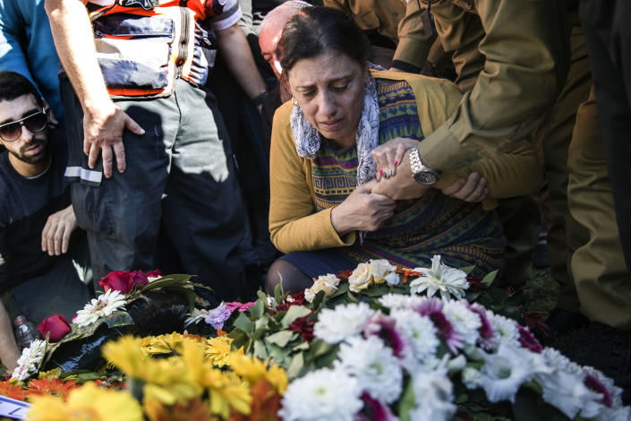 Friends and family of killed Israeli soldier Staff Sgt. Yovel Mor Yosef mourn during his funeral in Ashkelon, Israel, Friday, Dec. 14, 2018. Yosef was one of two Israeli soldiers killed by Palestinian gunman in the West Bank Thursday, Israel, Friday, Dec. 14, 2018. (AP Photo/Tsafrir Abayov)