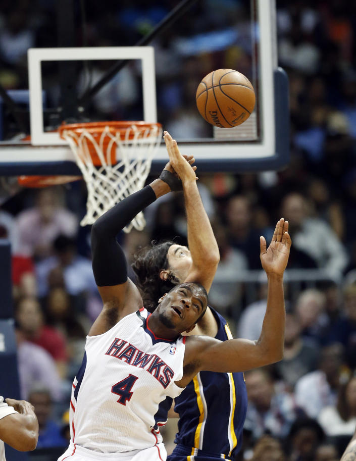Atlanta Hawks forward Paul Millsap, foreground, and Indiana Pacers forward Luis Scola battle for a jump ball in the first half of Game 3 of an NBA basketball first-round playoff series on Thursday, April 24, 2014, in Atlanta. (AP Photo/John Bazemore)