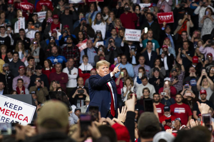 President Donald Trump points toward the crowd at the conclusion of a
