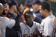 Detroit Tigers' Daz Cameron, center, is greeted in the dugout after hitting a solo home run during the fifth inning of the team's baseball game against the Los Angeles Angels in Anaheim, Calif., Saturday, June 19, 2021. (AP Photo/Kyusung Gong)