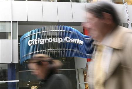 People walk past the Citigroup headquarters in New York