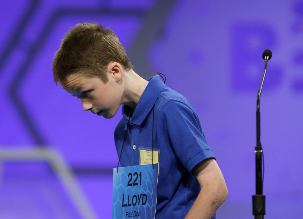 Lloyd Bonds of Olanta, South Carolina walks off stage after misspelling his word during round two of the preliminaries at the Scripps-Howard National Spelling Bee at National Harbor, Maryland May 28, 2014. REUTERS/Gary Cameron (UNITED STATES - Tags: EDUCATION SOCIETY)