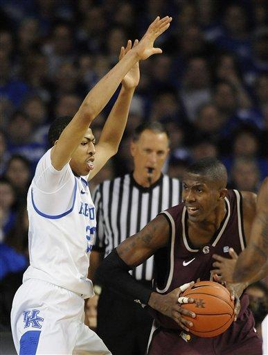 Kentucky's Anthony Davis, left, applies defensive pressure to Arkansas-Little Rock's Michael Javes during the first half of their NCAA college basketball game, Tuesday, Jan. 3, 2012, at Freedom Hall in Louisville, Ky. Kentucky defeated UALR 73-51. (AP Photo/Timothy D. Easley)