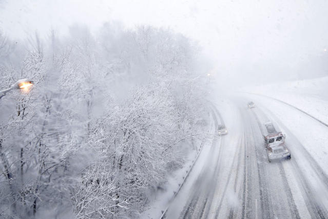 <p>Vehicles travel north over a snow-covered Interstate 287 during a storm on March 7, 2018, in Morristown, N.J. (Photo: Julio Cortez/AP) </p>