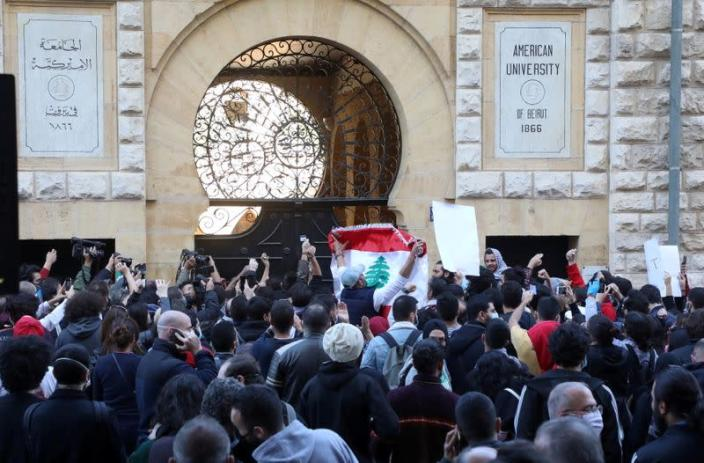 FILE PHOTO: Students from American Univeristy of Beirut protest over tuition fees in Beirut