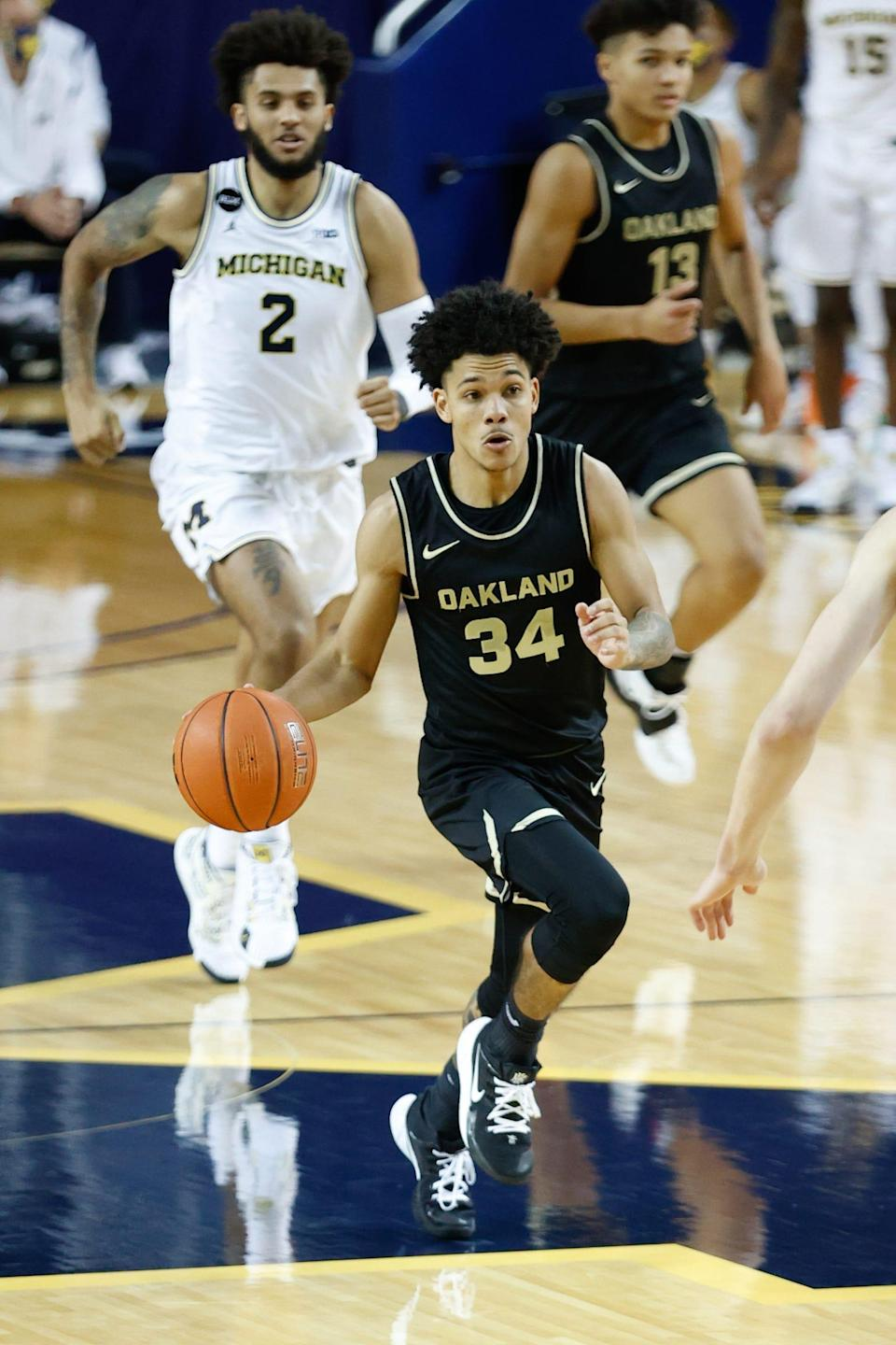 Oakland Golden Grizzlies guard Jalen Moore (34) dribbles in the second half against the Michigan Wolverines on Nov. 28, 2020, at Crisler Center in Ann Arbor.