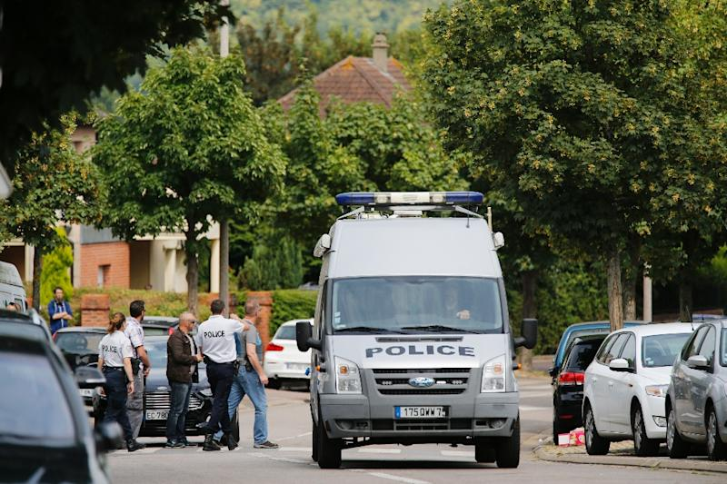 French policemen on July 26, 2016 in the Normandy city of Saint-Etienne du Rouvray after a priest was killed (AFP Photo/Matthieu Alexandre)
