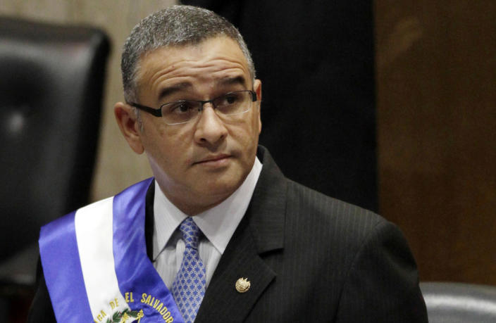 FILE - In this June 1, 2012 file photo, El Salvador's President Mauricio Funes stands in the National Assembly before speaking to commemorate the anniversary of his third year in office in San Salvador, El Salvador. Funes, who became president with the Farabundo Martí National Liberation Front party, is sought by prosecutors in El Salvador on corruption charges. He lives in exile in Nicaragua. (AP Photo/Luis Romero, File)
