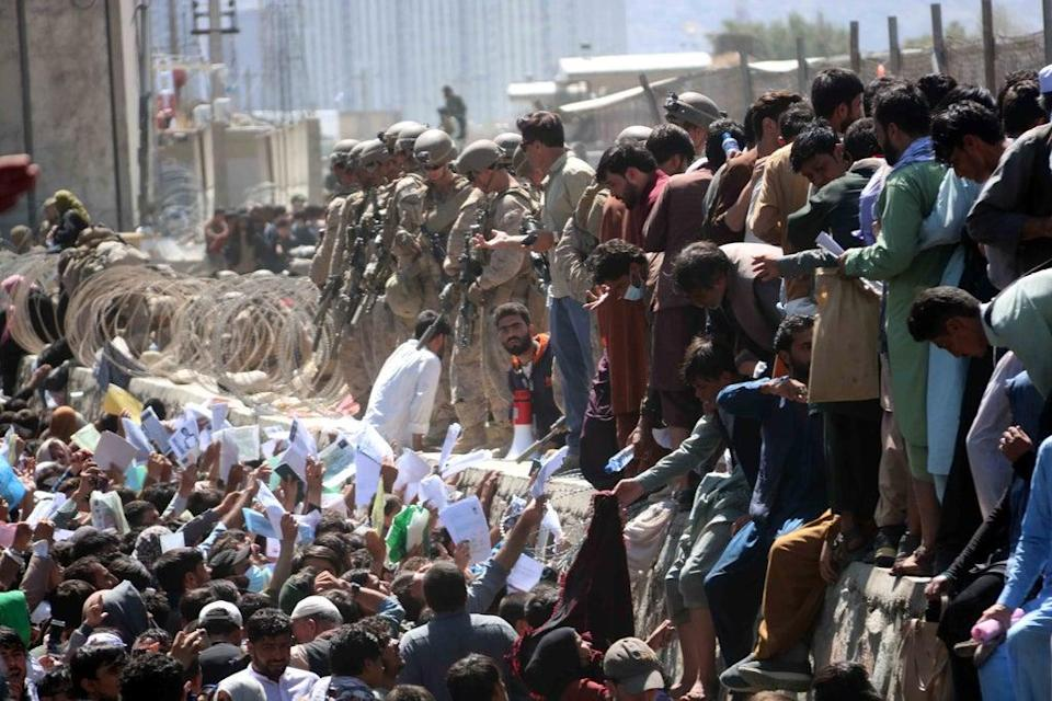 Afghans struggle to gain entry to the Hamid Karzai International Airport in Kabul (EPA)