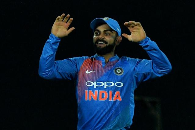 India's captain Virat Kohli celebrates the dismissal of a New Zealand batsman during their Twenty20 match in Thiruvananthapuram, on November 7, 2017 (AFP Photo/Manjunath KIRAN)