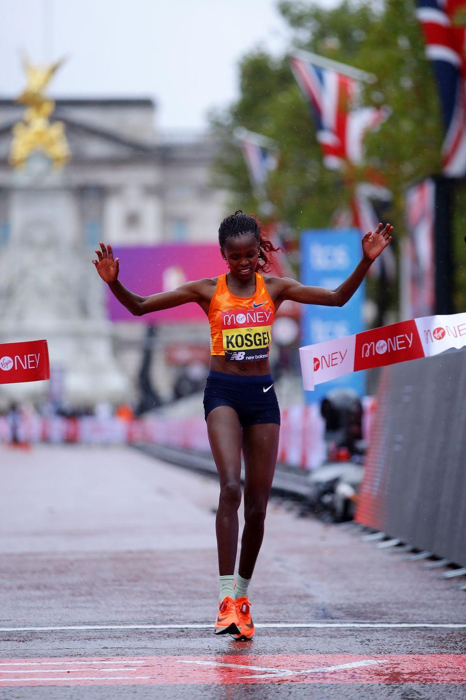 <p>Brigid Kosgei breaks the tape to win the 2020 London Marathon</p>