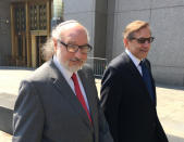 FILE - In this July 22, 2016, file photo convicted spy Jonathan Pollard, left, with his lawyer, Eliot Lauer, leaves federal court in New York following a hearing. Israeli media say Pollard, who spent 30 years in U.S. prison for spying for Israel, has landed in the country with his wife. The U.S. Justice Department announced in November that Pollard had completed his parole, clearing the way for him to move to Israel 35 years after he was arrested. Pollard has said it was his dream to move to the country.(AP Photo/Larry Neumeister, File)