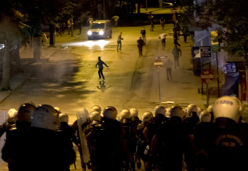 Turkish riot police charge toward protesters during clashes in Ankara, Turkey, Tuesday, June 11, 2013. Turkey's Prime Minister Recep Tayyip Erdogan will meet with a group of protesters occupying Istanbul's central Taksim Square this week, Deputy Prime minister Bulent Arinc said Monday, as the government sought a way out of the impasse that has led to hundreds of protests in dozens of cities. (AP Photo/Vadim Ghirda)