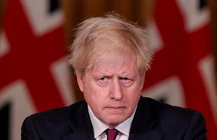 Britain's Prime Minister Boris Johnson looks on during a news conference in response to the ongoing situation with the coronavirus disease (COVID-19) pandemic, inside 10 Downing Street, London, Britain, December 19, 2020. REUTERS/Toby Melville/Pool     TPX IMAGES OF THE DAY