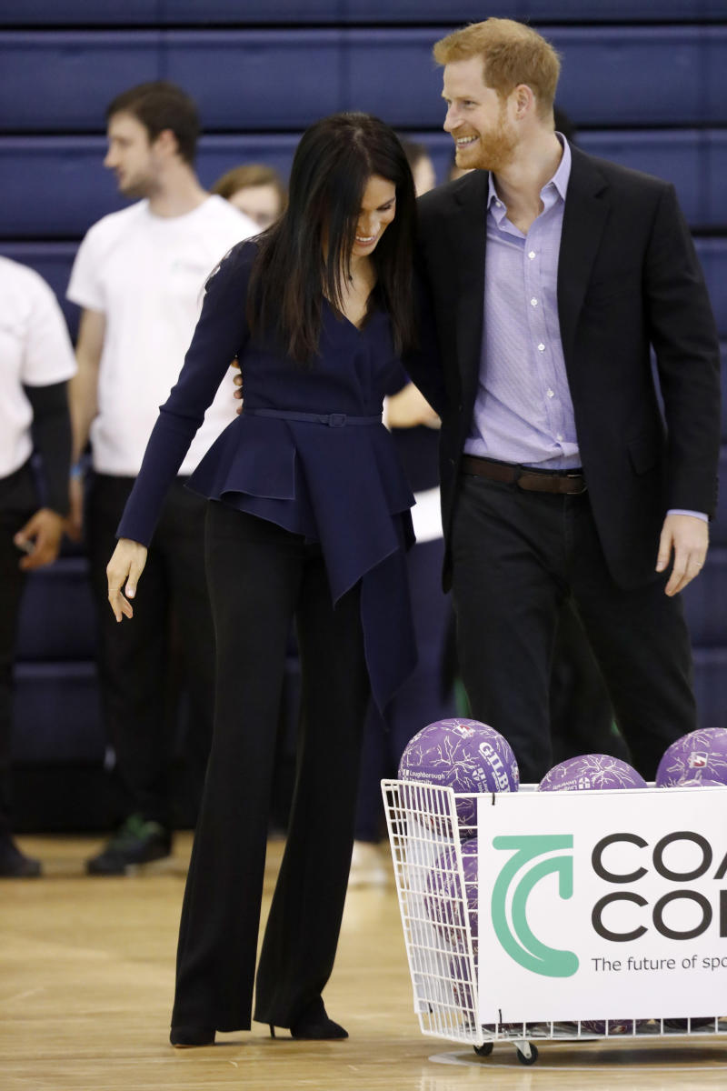 The Duke and Duchess of Sussex sharing a laugh at the Coach Core Awards on Sept. 24. (Chris Jackson via Getty Images)