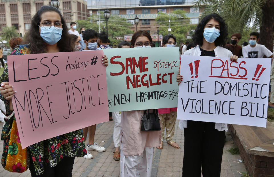 Women's rights activists take part in a demonstration to condemn the violence against women, in Lahore, Pakistan, Saturday, July 24, 2021. The beheading of a young woman in an upscale neighborhood of Pakistan's capital has shone a spotlight on the relentless violence against women in the country. Rights activists say such gender-based assaults are on the rise as Pakistan barrels toward greater religious extremism. (AP Photo/K.M. Chaudhry)