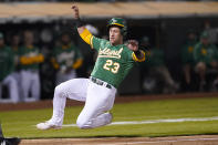 Oakland Athletics' Yan Gomes slides home to score against the San Francisco Giants during the fourth inning of a baseball game in Oakland, Calif., Friday, Aug. 20, 2021. (AP Photo/Jeff Chiu)