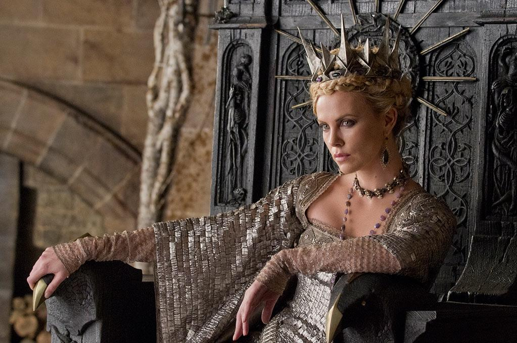 """<b>Queen Ravenna</b><br> The elaborate costumes Charlize Theron wears in """"Snow White and the Huntsman,"""" including a spiky crown, were made by famed costume designer Coleen Atwood (""""Edward Scissorhands,"""" """"Chicago,"""" and even """"Dark Shadows""""). Surprisingly, both Charlize and her co-star Kristen Stewart, had a lot of input in the making of their respective attire. """"With Charlize, the character dictated it more than her look,"""" Atwood <a href=""""http://collider.com/colleen-atwood-snow-white-huntsman-thin-man-interview/164379/"""">recently said</a>. Theron also plays an icy character in the much-anticipated """"Alien"""" prequel """"Prometheus,"""" in theaters June 8th -- just a week after """"Snow White and the Hunstman"""" opens."""