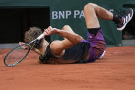 Germany's Alexander Zverev falls on the clay as he plays compatriot Oscar Otte during their first round match of the French Open tennis tournament at the Roland Garros stadium Sunday, May 30, 2021 in Paris. (AP Photo/Michel Euler)