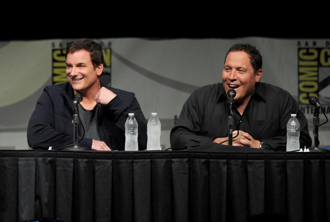 "SAN DIEGO, CA - JULY 14:  Director Shane Black (L) and actor Jon Favreau speak at Marvel Studios ""Iron Man 3"" panel during Comic-Con International 2012 at San Diego Convention Center on July 14, 2012 in San Diego, California.  (Photo by Kevin Winter/Getty Images)"