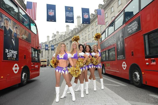 In this image made available by the NFL, Minnesota Vikings cheerleaders stand in London's Regent Street during an arranged photo shoot, Wednesday, Sept. 25, 2013. The Minnesota Vikings will play the Pittsburgh Steelers at London's Wembley Stadium on Sunday. (AP Photo/NFL, Dave Shopland)