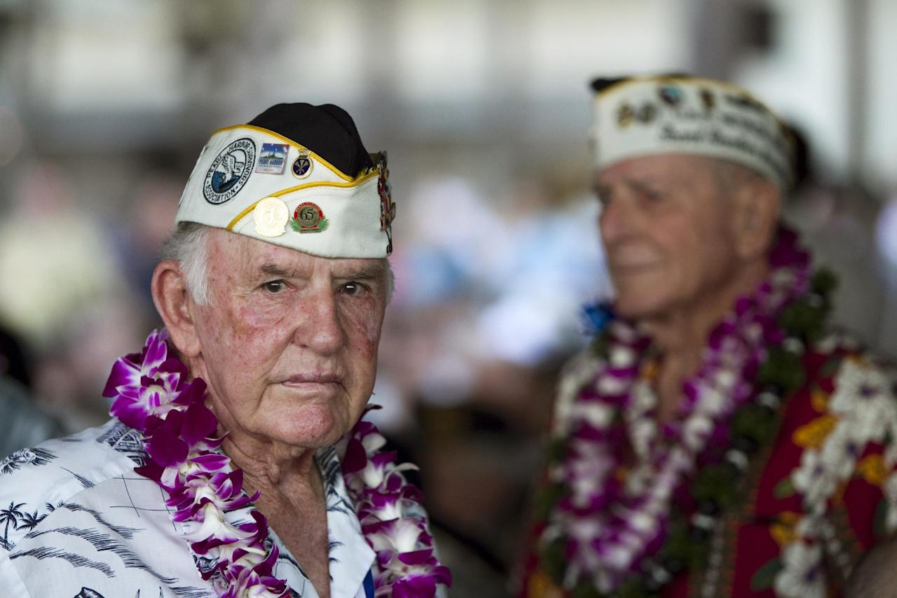 Pearl Harbor survivor Earl Smith is seen at the memorial ceremony, Wednesday, Dec. 7, 2011, in Pearl Harbor, Hawaii. Today marks the 70th anniversary of the surprise attack on Pearl Harbor Naval Base which pulled the US into a war with Japan. (AP Photo/Marco Garcia)