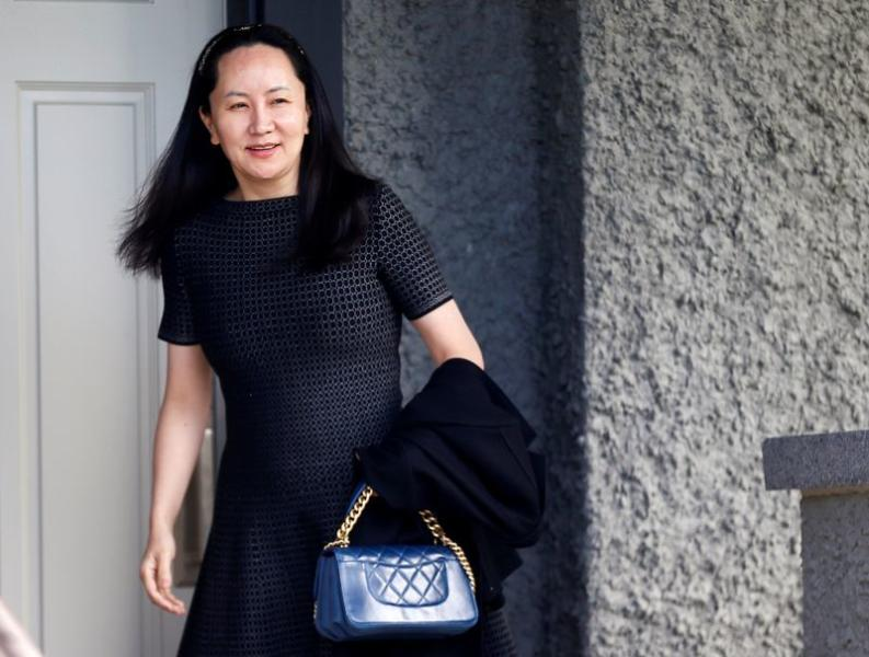 FILE PHOTO: Huawei's Financial Chief Meng Wanzhou leaves her family home in Vancouver, British Columbia
