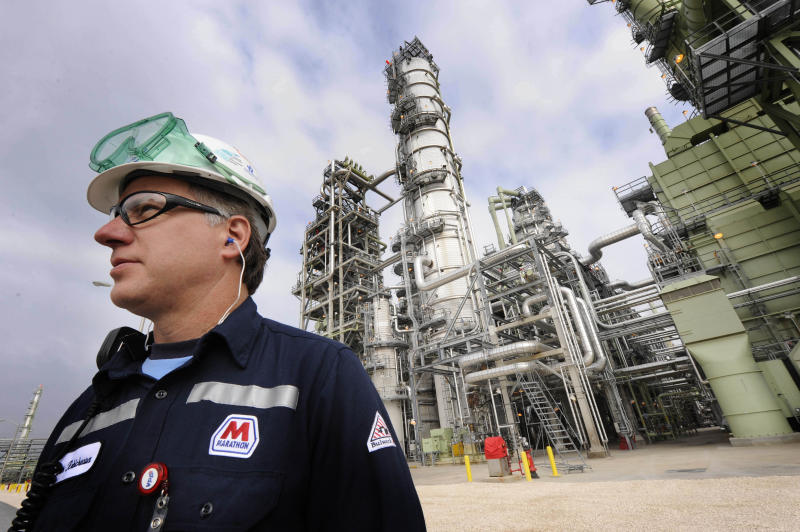 FILE - In this March 25, 2010 file photo, Don Robicheaux, safety coordinator for Marathon, stands in front of the new crude unit, part of Marathon's estimated $3.2 billion expansion in Garyville, La. Marathon Oil Corp. said Tuesday, Nov. 2, 2010, that its profit climbed 68.5 percent as it increased production and enjoyed higher prices for both oil and natural gas. (AP Photo/Cheryl Gerber, file)