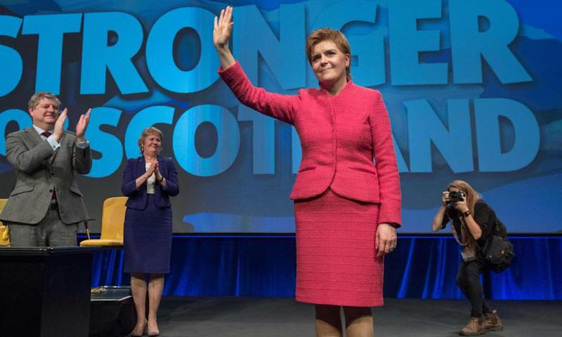 Scotland's first minister Nicola Sturgeon gestures to the audience after making her closing speech during the Scottish National Party conference in Aberdeen on Saturday.