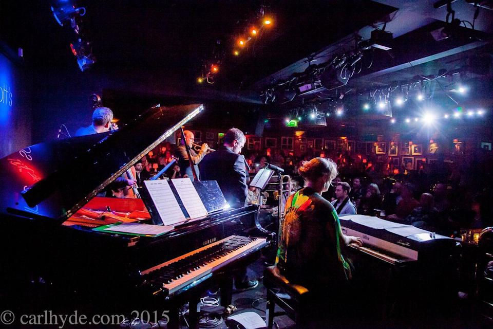 """<p>Then there is, of course, Ronnie Scott's. The classic jazz venue has held court in Soho's winding streets since 1959, cementing its reputation as the ultimate night out for great music and a blinding atmosphere. </p><p>Finally back in business after the chaos of the past year, Ronnie's has got a brilliant roster of homegrown talent performing this season. Upcoming shows feature Ray Gelato and the Giants, the London City Big Band, Mica Paris, and Natalie Williams' Soul Family.</p><p>There are also some new additions for 2021. Alongside a whole programme of virtual screenings, Saturday morning brunch is now on the menu. Its a 10.30am start, with live music, comedians and cabaret stars of the West End performing one-off shows, alongside two courses and two of the house's classic cocktails. </p><p>Early birds and night owls rejoice. </p><p><a class=""""link rapid-noclick-resp"""" href=""""https://www.ronniescotts.co.uk/performances/view/6475-all-that-jazz-ronnies-saturday-cabaret-brunch-includes-2-courses-2-cocktails"""" rel=""""nofollow noopener"""" target=""""_blank"""" data-ylk=""""slk:BOOK NOW"""">BOOK NOW</a></p>"""