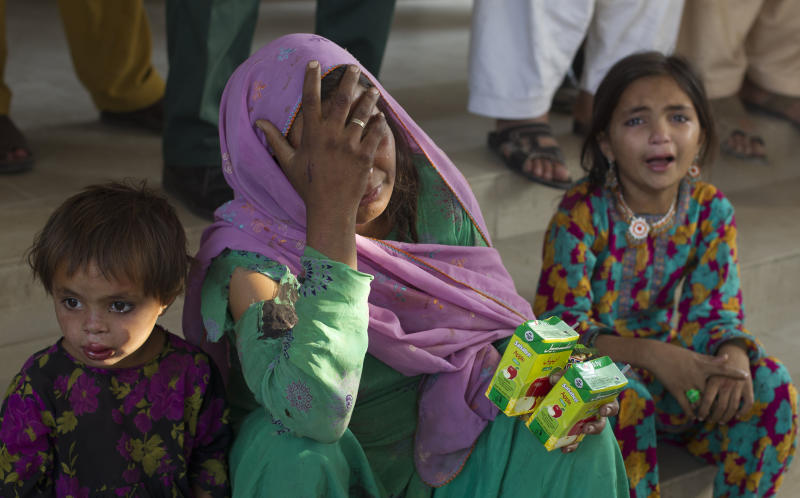 Family members of a victim of a bus accident cry at a local hospital in Kahuta, near Rawalpindi, Pakistan, Monday, June 4, 2012. The bus carrying a wedding party into a ditch in Kahuta, killing 20 people, a government health official said. (AP Photo/B.K. Bangash)