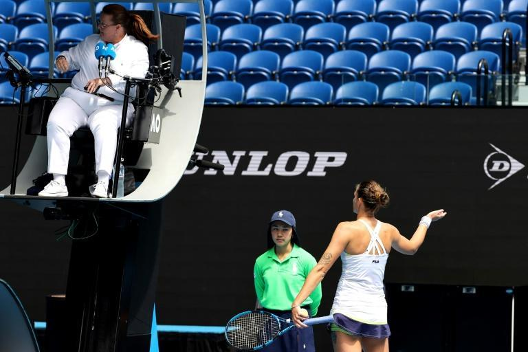 Karolina Pliskova argues in vain with umpire Alison Hughes after being penalised a point for smashing her racquet off court