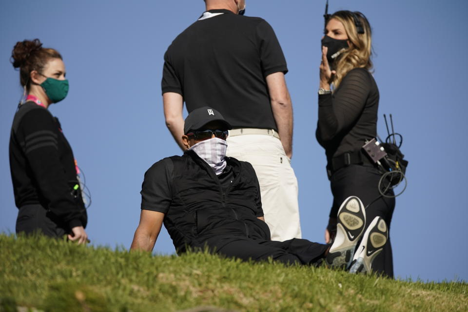 Tiger Woods is seen looking down at the 18th hole from the practice green during the final round of the Genesis Invitational golf tournament at Riviera Country Club, Sunday, Feb. 21, 2021, in the Pacific Palisades area of Los Angeles. (AP Photo/Ryan Kang)