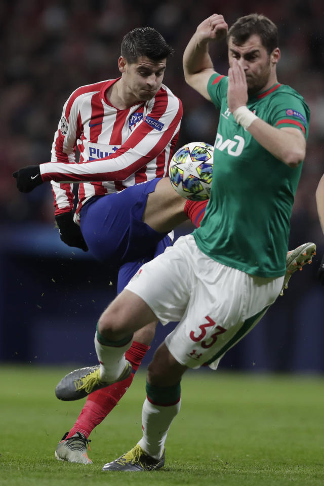 Atletico Madrid's Alvaro Morata kicks the ball past Lokomotiv's Solomon Kvirkvelia during the Champions League Group D soccer match between Atletico Madrid and Lokomotiv Moscow at Wanda Metropolitano stadium in Madrid, Spain, Wednesday, Dec. 11, 2019. (AP Photo/Manu Fernandez)