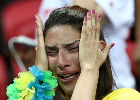 FILE PHOTO: World Cup - Quarter Final - Brazil vs Belgium - Kazan Arena, Kazan, Russia - July 6, 2018 Brazil fan looks dejected after the match REUTERS/Sergio Perez/File Photo