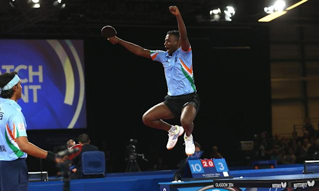 India's Anthony Arputharaj, right, and Sharat Kamal Achanta celebrate after defeating Singapore's Jian Zhan and Zi Yang in the Men's Doubles Table tennis semi-final at Hampden Park Stadium during the Commonwealth Games 2014 in Glasgow, Scotland, Friday, August 1, 2014. (AP Photo/Peter Morrison)