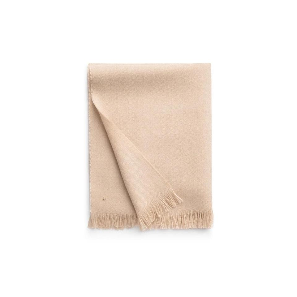 """The mom who runs cold will immediately want to curl up on the couch with this cozy alpaca scarf. She can wrap it around her shoulders or neck. Either way, it's a win. $75, Cuyana. <a href=""""https://www.cuyana.com/alpaca-scarf.html#beige"""" rel=""""nofollow noopener"""" target=""""_blank"""" data-ylk=""""slk:Get it now!"""" class=""""link rapid-noclick-resp"""">Get it now!</a>"""