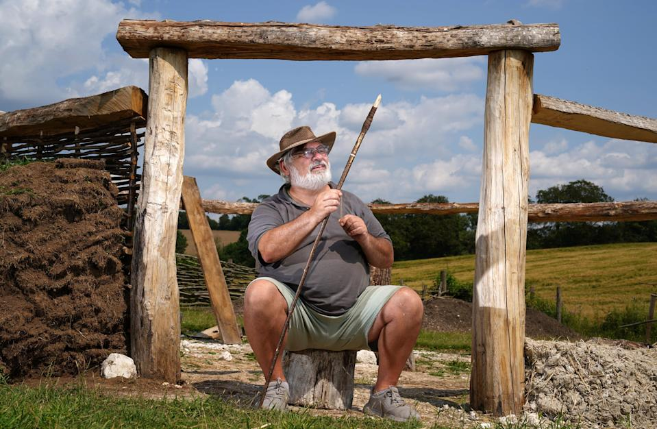 Veteran Kevin Reilly helps with work on a bronze age roundhouse (Andrew Matthews/PA) (PA Wire)