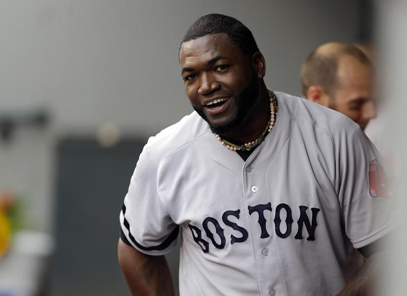Boston Red Sox's David Ortiz reacts in the dugout after he scored a run in the second inning after hitting a double against the Seattle Mariners, Wednesday, July 10, 2013, in Seattle. With the hit, Ortiz' 1689th in his MLB career, he passed the record held by Harold Baines for the most hits as a designated hitter in major league history. (AP Photo/Ted S. Warren)