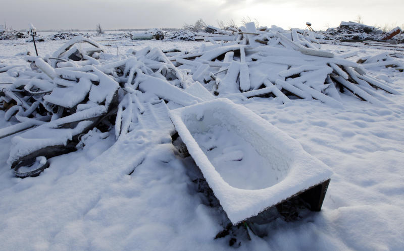 Snow covers a demolished house in Marysville, Ind., Monday, March 5, 2012 after a tornado ripped through the town on Friday, March 2. (AP Photo/Nam Y. Huh)