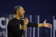 Michigan head coach Juwan Howard yells from the sideline during the first half of an NCAA college basketball game against Maryland, Tuesday, Jan. 19, 2021, in Ann Arbor, Mich. (AP Photo/Carlos Osorio)